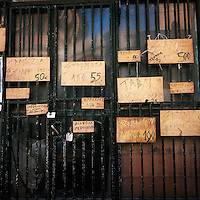 A wood workshop displaying its prices on the entrance door..