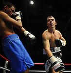 Jeff Evans (Black Shorts) V Jamie Ambler (Blue Shorts).Joe Calzaghe Promotions Boxing Evening .Date: Friday 20/11/2009,  .© Ian Cook IJC Photography, 07599826381, iancook@ijcphotography.co.uk,  www.ijcphotography.co.uk, .