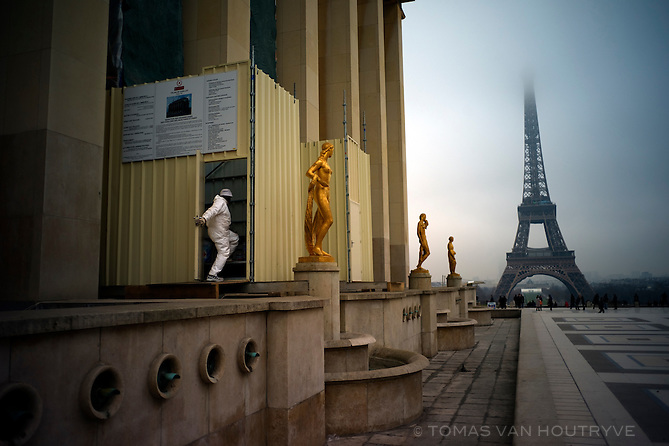 The Eiffel Tower partially covered in clouds is seen from Trocadero in Paris on 18 January 2010.