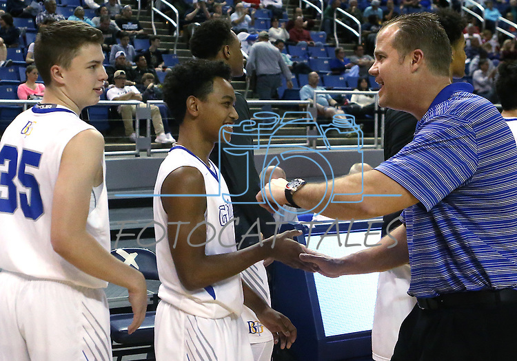 Bishop Gorman Head Coach Grant Rice celebrates with Chance Michaels, left, and DJ Howe after a 70-39 victory over Reno during the NIAA Division I state basketball tournament in Reno, Nev. on Thursday, Feb. 25, 2016. Cathleen Allison/Las Vegas Review-Journal