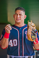 23 May 2015: Washington Nationals catcher Wilson Ramos prepares for play in the dugout prior to a game against the Philadelphia Phillies at Nationals Park in Washington, DC. The Phillies defeated the Nationals 8-1 in the second game of their 3-game weekend series. Mandatory Credit: Ed Wolfstein Photo *** RAW (NEF) Image File Available ***