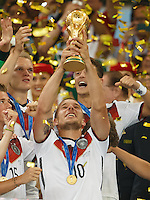 Lukas Podolski of Germany lifts the World Cup trophy after winning the 2014 final