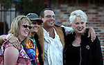 From left, Christy McOmber, Sue Jones, Kyle Horvath and Ronni Hannaman pose for photos at the first annual Blinky Man event in downtown Carson City, Nev., on Wednesday, June 19, 2013.<br />