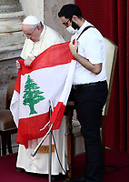 Pope Francis (L) and Georges Breidi, a Lebanese priest, hold Lebanon's flag as they pray for Lebanon during the first limited public audience at the San Damaso courtyard in The Vatican on September 2, 2020 during the COVID-19 infection, caused by the novel coronavirus.<br /> UPDATE IMAGES PRESS/Isabella Bonotto<br /> <br /> STRICTLY ONLY FOR EDITORIAL USE