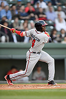 Third baseman Jean Carlos Encarnacion (14) of the Rome Braves bats in a game against the Greenville Drive on Thursday, April 12, 2018, at Fluor Field at the West End in Greenville, South Carolina. Greenville won, 14-4. (Tom Priddy/Four Seam Images)