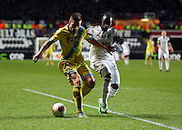 Swansea, UK. Thursday 20 February 2014<br /> Pictured L-R: Christian Maggio of Napoli is challenged by Marvin Emnes of Swansea.<br /> Re: UEFA Europa League, Swansea City FC v SSC Napoli at the Liberty Stadium, south Wales, UK