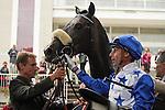 Winning jockey, Gérald Mossé, debriefing the race Qatar Prix Niel, horse : Reliable Man and his lad