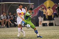Fredy Montero (17) of the Seattle Sounders plays the ball while defended by Alfredo Pacheco (16) of the New York Red Bulls. The New York Red Bulls  and the Seattle Sounders played to a 1-1 tie during a Major League Soccer match at Giants Stadium in East Rutherford, NJ, on June 20, 2009.