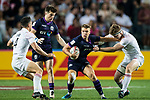 Gavin Lowe of Scotland is tackled by William Frederick Wilson of England during their Pool C match between England and Scotland as part of the HSBC Hong Kong Rugby Sevens 2018 on 06 April 2018, in Hong Kong, Hong Kong. Photo by Marcio Rodrigo Machado / Power Sport Images