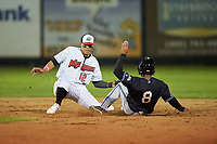 Great Falls Voyagers shortstop Lency Delgado (12) applies the tag to Cesar Garcia (8) during a Pioneer League game against the Missoula Osprey at Centene Stadium at Legion Park on August 19, 2019 in Great Falls, Montana. Missoula defeated Great Falls 1-0 in the second game of a doubleheader. (Zachary Lucy/Four Seam Images)