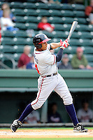 Shortstop Johan Camargo (24) of the Rome Braves bats in a game against the Greenville Drive on Thursday, July 31, 2014, at Fluor Field at the West End in Greenville, South Carolina. Rome won the rain-shortened game, 4-1. (Tom Priddy/Four Seam Images)