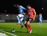 Lincoln City's Ramirez Howarth vies for possession with Manchester City U21's Claudio Gomes<br /> <br /> Photographer Chris Vaughan/CameraSport<br /> <br /> EFL Papa John's Trophy - Northern Section - Group E - Lincoln City v Manchester City U21 - Tuesday 17th November 2020 - LNER Stadium - Lincoln<br />  <br /> World Copyright © 2020 CameraSport. All rights reserved. 43 Linden Ave. Countesthorpe. Leicester. England. LE8 5PG - Tel: +44 (0) 116 277 4147 - admin@camerasport.com - www.camerasport.com