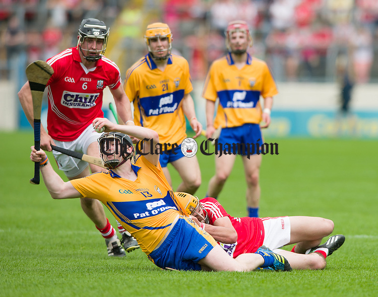 John Cronin of Cork in action against Mikey O Neill of Clare during their Intermediate hurling game at Thurles. Photograph by John Kelly.
