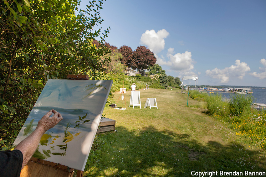Chautauqua School of Art students in Margaret Grimes' landscape class paint at the water's edge on Lake Chautauqua. The Institution runs a series of schools that span the summer season art, dance and music are among them. Chautauqua, NY. June 27, 2014. Photo by Brendan Bannon