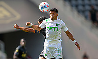LOS ANGELES, CA - APRIL 17: Rodney Redes #11 Austin FC heads a ball during a game between Austin FC and Los Angeles FC at Banc of California Stadium on April 17, 2021 in Los Angeles, California.