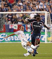 Los Angeles Galaxy midfielder (8) Peter Vagenas tackles New England Revolution midfielder (21) Shalrie Joseph. The New England Revolution defeated the Los Angeles Galaxy 1-0 during an MLS regular season match at Gillette Stadium, Foxborough, MA, on August 12, 2007.