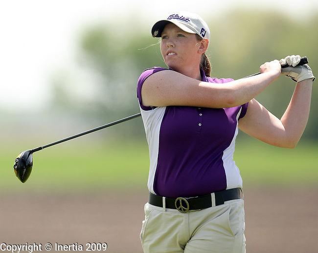 SIOUX FALLS, SD - MAY 18:  Nicole Funck of Dakota Valley watches her tee shot on the 11th hole during the first round of the 2009 Class 'A' Girls Golf Tournament Monday at Central Valley in Hartford. (Photo by Dave Eggen/Inertia).