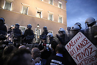 Pictured: Protesters and riot police officers on the steps of the Parliament Thursday 18 May 2017<br /> Re: Clashes between anti fourth memorandum protesters and riot police in front of the Parliament building in Syntagma Square, Athens, Greece