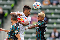 CARSON, CA - APRIL 25: Andrew Gutman  #5 of the New York Red Bulls battles with Julian Araujo #2 of the Los Angeles Galaxy for a head ball during a game between New York Red Bulls and Los Angeles Galaxy at Dignity Health Sports Park on April 25, 2021 in Carson, California.