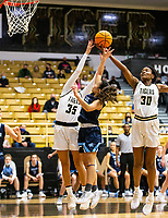 Jada Brown (35) of Bentonville and Maryam Dauda  (30) of Bentonville go up for rebound between Galatia Andrew (11) of Spring Har-ber at Tiger Arena, Bentonville, AR January 5, 2021 / Special to NWA Democrat-Gazette/ David Beach