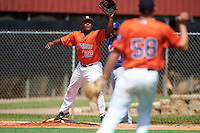 GCL Astros first baseman Cristopher Luciano (23) stretches for a throw from third baseman Brody Westmoreland (58) during the first game of a doubleheader against the GCL Mets on August 5, 2016 at Osceola County Stadium Complex in Kissimmee, Florida.  GCL Astros defeated the GCL Mets 4-1 in the continuation of a game started on July 21st and postponed due to inclement weather.  (Mike Janes/Four Seam Images)