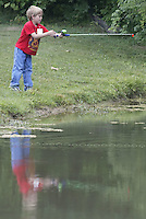 Jarrhett Grow (6), of Spring Valley, fishes from the bank of the lake during a fishing derby Saturday, June 11, 2005, in Bellbrook, Ohio.