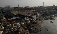 "The ""river side"" in a trash town called Lin Jiao in China. Lin Jiao near Nanhai in China's Guangdong Province is a heavily polluted township that recycles waste plastic, much of which is brought from European countries..30 Aug 2006"