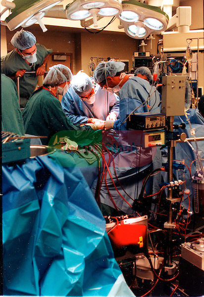 NOT MODEL RELEASED; FOR EDITORIAL USE ONLY... surgical team performing heart valve replacement
