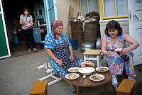 REPUBLIC OF MOLDOVA, Gagauzia, Vulcanesti, 2009/06/30..Viera, his sister Anna and her stepmother Fiedora eat a soup prepared with Borshi. We find this type of diner table in every family Gagauz..© Bruno Cogez / Est&Ost Photography..REPUBLIQUE MOLDAVE, Gagaouzie, Vulcanesti, 30/06/2009..Viera, sa soeur Anna et sa belle mère Fiedora mangent une soupe préparée à base de borsh. On retrouve ce type de table basse dans toutes les familles gagaouzes..© Bruno Cogez / Est&Ost Photography