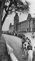1968 FILE PHOTO - ARCHIVES -<br /> <br /> More than 80,000 mourners braved cold winds and cloudy skies over the weekend to file past the bier in the Quebec legislature where the body of Quebec Premier Daniel Johnson lay in state. Line was a mile long at times.<br /> <br /> 1968<br /> <br /> PHOTO : Graham Bezant - Toronto Star Archives - AQP