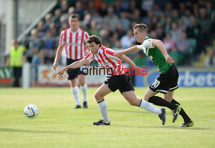 10 July 2014; Barry McNamee, Derry City, in action against Chris Venables, Aberystwyth Town. UEFA Europa League First Qualifying Round, Second Leg, Aberystwyth Town v Derry City. Park Avenue, Aberystwth, Wales. Picture credit: Ian Cook / SPORTINGWALES