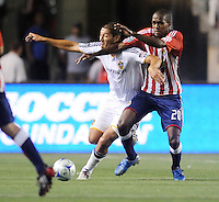 Chivas USA (20) Atiba Harris fights off  Los Angeles Galaxy's (4) Omar Gonzales for the ball at the Home Depot Center. Los Angeles Galaxy 1-0 over the Chivas USA, Saturday, Jul. 11. 2009, in Carson, California.