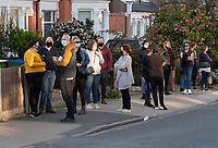 Younger people queueing outside after 6pm for the vaccine during COVID-19 Vaccinations at Aspire Pharmacy, Hadlow Road, Sidcup, Kent, England on the 29 March 2021. Photo by Alan Stanford.
