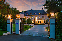 BNPS.co.uk (01202 558833)<br /> Pic: Savills/BNPS<br /> <br /> Pictured: The front of the chateau at night.<br /> <br /> A striking turreted French style chateau in one of the UK's most desirable streets is on the market for £9.25m.<br /> <br /> Deauville is an impressive mansion with a striking period exterior but a stylish contemporary look inside and all the mod cons a home owner would want, including an indoor pool complex and cinema room.<br /> <br /> The house is in the prestigious St George's Hill estate in Weybridge, Surrey, which is renowned all over the world.<br /> <br /> The five-bedroom house was built in 2000 but has undergone an extensive refurbishment in the last few years.