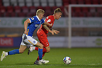 Jordan Maguire-Drew of Leyton Orient battles with Alex Cochrane of Brighton & Hove Albion (U23s) during the EFL Trophy behind closed doors match between Leyton Orient and Brighton & Hove Albion Under 21s at the Matchroom Stadium, London, England played without supporters able to attend due to ongoing covid-19 government guidelines on 8 September 2020. Photo by Vince  Mignott.