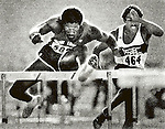 Roger Kingdom of Monroeville, PA, and the University of Pittsburgh, pulls ahead of Henry Andrade at the Olympics Trials in Los Angeles to qualify for a berth on the U.S. Olympic track team. He went on to win a gold medal. (Photo by Jim Mendenhall for the Pittsburgh Press) June 1984 photo. corporate logo removed from hurdle (KODAK)
