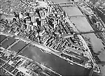 Pittsburgh PA: Aerial view of the city of Pittsburgh.  Brady Stewart took this photo after the completion of the new Grant and Kopper's buildings.  The image shows how the railroads weaved through and around the city during this time.