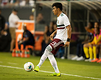 CHARLOTTE, NC - JUNE 23: Jesus Gallardo #23 passes the ball during a game between Mexico and Martinique at Bank of America Stadium on June 23, 2019 in Charlotte, North Carolina.