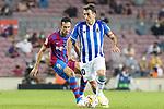 FC Barcelona's Sergio Busquets (l) and Real Sociedad's Mikel Oyarzabal during La Liga match. August 15, 2021. (ALTERPHOTOS/Acero)