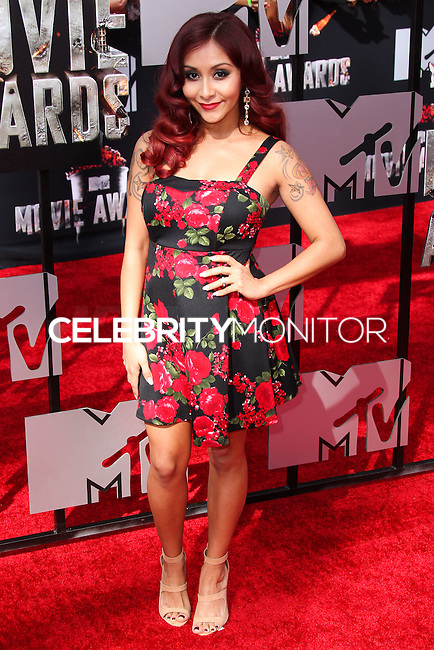 LOS ANGELES, CA, USA - APRIL 13: Snooki (Nicole Polizzi) arrives at the 2014 MTV Movie Awards held at Nokia Theatre L.A. Live on April 13, 2014 in Los Angeles, California, United States. (Photo by Xavier Collin/Celebrity Monitor)