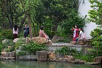 Yangzhou, Jiangsu, China.  Chinese Taking Pictures, Slender West Lake Park.