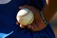 """Dunedin Blue Jays player holding a baseball while wearing an """"I am Second"""" bracelet during practice before a game against the Clearwater Threshers on April 8, 2016 at Bright House Field in Clearwater, Florida.  Dunedin defeated Clearwater 8-3.  (Mike Janes/Four Seam Images)"""
