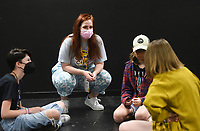 """Summer Programs Manager Alexa Bella (second from left) ask questions as Amerson Moll (from left) Marisol Capra and Addie Lundy plan participate their tableaus, an acting method creating frozen pictures on stage, Monday, July 19, 2021 at Trike Theater in Bentonville. Local high schoolers participated in a two week, self-devised camp in preparation for a senior performance of Tiger In My Suit. The students use different acting strategies to create stories and unpack emotions through theater, said Alexa Bella, the summer programs manager. """"We're just excited to be back from last year being fully virtual,"""" she said. """"It's a little hard getting everyone out of their shells on Zoom. It's their first summer hosting camps in their new building. Check out nwaonline.com/210720Daily/ for today's photo gallery. <br /> (NWA Democrat-Gazette/Charlie Kaijo)"""
