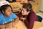 Education Preschool 4-5 year olds boy talking about problem with teacher