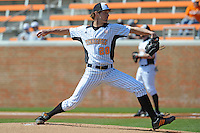 Drew Steckenrider #20 of the Tennessee Volunteers delivers a pitch at Lindsey Nelson Stadium against the the Manhattan Jaspers on March 12, 2011 in Knoxville, Tennessee.  Tennessee won the first game of the double header 11-5.  Photo by Tony Farlow / Four Seam Images..