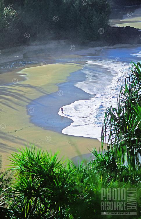 Man standing at Lumahai beach, North shore, Kauai
