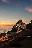 Sunset bouldering session at St Bees Head North, 4+/V0, Lake District, United Kingdom
