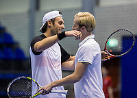 Rotterdam, Netherlands, December 14, 2016, Topsportcentrum, Lotto NK Tennis,  Matchpoint: doubles team Sidney de Boer (L) embrace his partner Botic van de Zandschulp (R) <br /> Photo: Tennisimages/Henk Koster