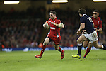 Wales wing Alex Cuthbert tries to beat Scotland centre Alex Dunbar on the outside.<br /> RBS 6 Nations 2014<br /> Wales v Scotland<br /> Millennium Stadium<br /> <br /> 15.03.14<br /> <br /> ©Steve Pope-SPORTINGWALES