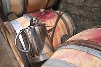 Topping up can. Oak barrel aging and fermentation cellar. Domaine Bertagna, Vougeot, Cote de Nuits, d'Or, Burgundy, France